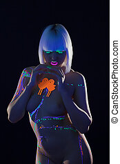 Naked woman with spectacular neon pattern on body