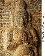 namaste - detail of a sculpture at mahabalipurum, tamil nadu...