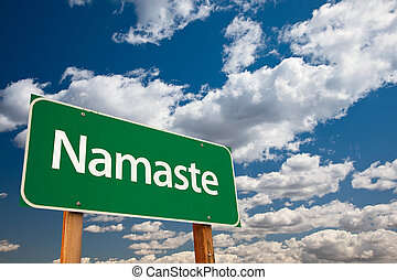 Namaste Green Road Sign with Copy Room Over The Dramatic...