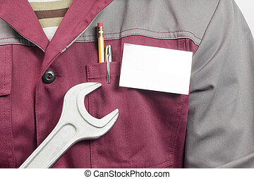 Name tag on uniform and wrench - Close-up of blank name tag...