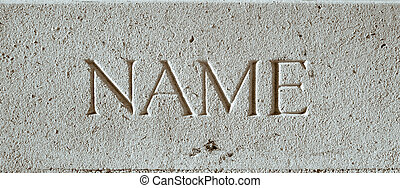 The word name engraved in a stone surface