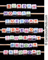 names of days of the week created of small white toy bricks with coloured letters