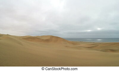 Namib Desert meets the Atlantic Ocean. Dunes of the Namib...