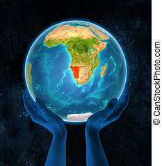 Namibia on Earth in hands