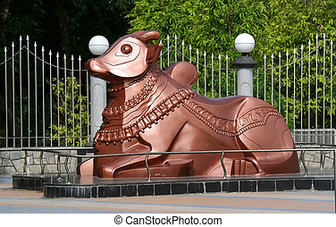 Copper colored Nandi statue at the entrance of a park in Hyderabad India