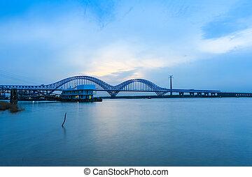 nanjing railway yangtze river bridge at dusk