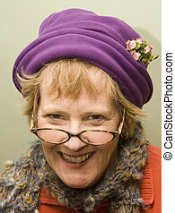 Nanny - Beauitful older woman wearing a purple hat and red...