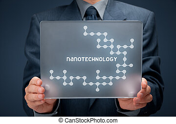 Nanotechnology concept. Man holding futuristic tablet pc...