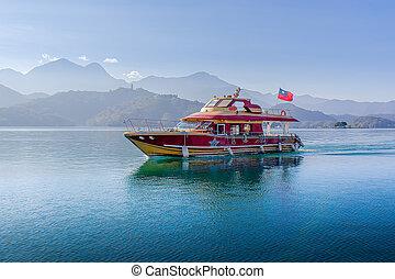 Boats at the lake of famous attraction, Sun Moon Lake at Taiwan.