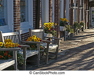 nantucket - old nantucket side walk with flowers and benchs