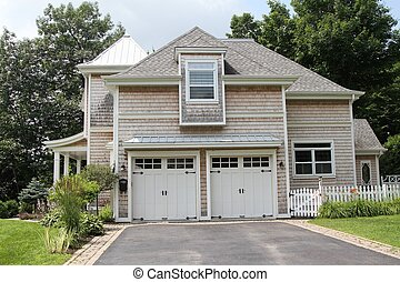 Nantucket style home with garages