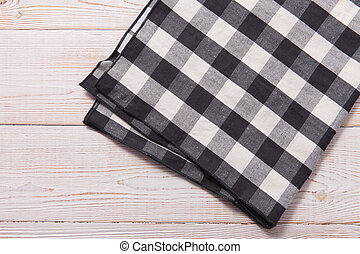 Napkin. Kitchen towel or table cloth on white wooden scene. Mock up for design. Top view.