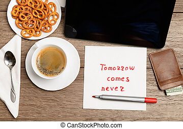 napkin message proverb on wooden table with coffee, some...