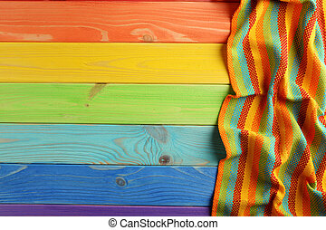 Napkin on colorful wooden table, close up