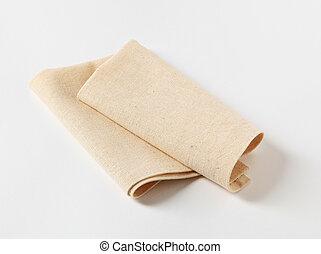 Napkin - Small folded linen napkin - studio shot