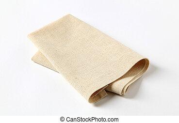 Small folded napkin on white background - closeup