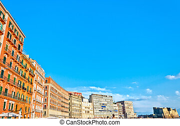 boardwalk buildings and Castel dell'Ovo in Naples, Italy
