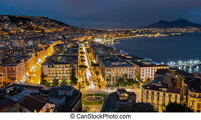 Naples, Italy. Evening city car traffic and the sea bay with...