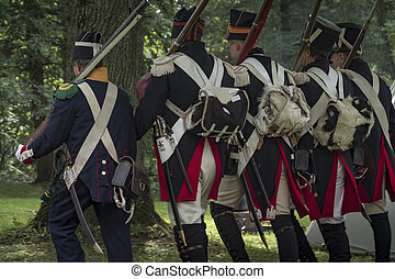 Napoleonic soldiers train to march in the forest