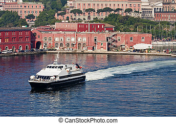 A blue and white ferry crossing the harbor of Naples Italy