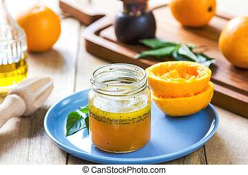 naranja, semilla de amapola, preparación de ensalada
