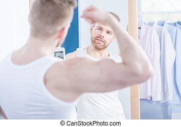 Narcissistic man taking photo