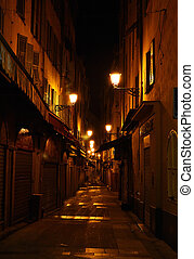 Narrow alley with lanterns in Nice