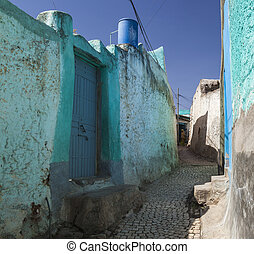 Narrow alleyway of ancient city of Jugol in the morning. ...
