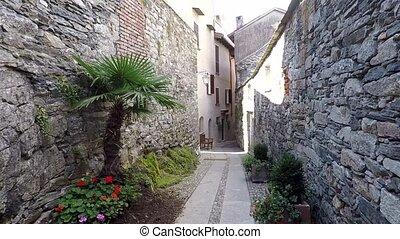 Narrow ancient italian street in Orta San Giulio