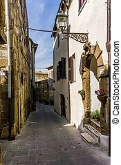 Narrow ancient street in the Pitigliano town in Tuscany Italy