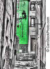 Narrow backstreet in Bosa old town in selective desaturation...