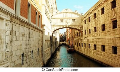 Narrow canal in Venice between old buildings, Italy - Narrow...