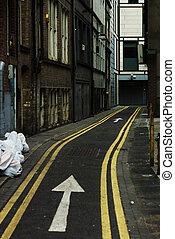 Narrow city street. Arrow sign one way. Manchester, England, Europe.