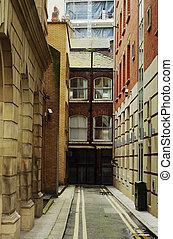 Narrow city street. Manchester, England, Europe.