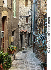 Narrow cobbled streets with flowers in the old village Gourdon, France