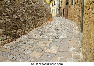 narrow curve street in italian village Montefioralle, Greve...