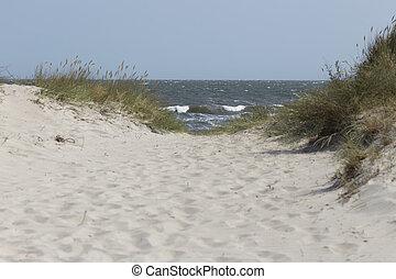 Narrow dune breakthrough