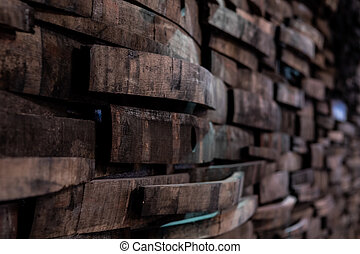 Narrow Focus of Bourbon Barrels on Wall from angle