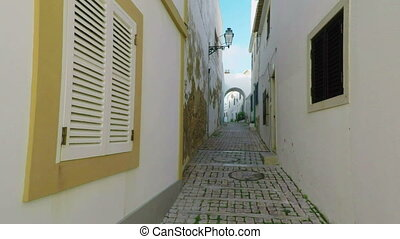 Narrow historical streets of the old city of Albufeira....