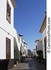 narrow lane and spanish villa