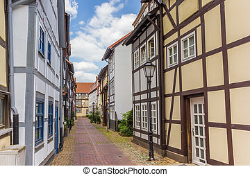 Narrow little street with hal-timbered houses in Hameln, Germany