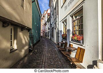 Narrow medieval street in old city of Riga, Latvia.