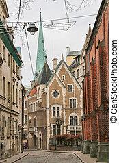 Narrow medieval street in the old Riga city, Latvia.