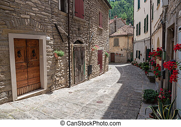 Narrow old street with flowers in Italy