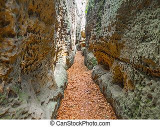Narrow passage in sandstone gorge of Maze rock city in Krivoklatsko protected area, Czech Republic