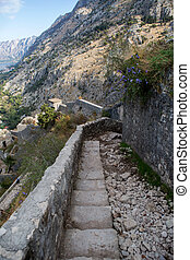 narrow stone road to the fortress wall