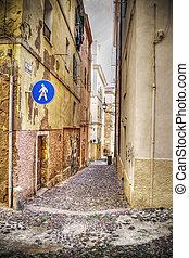 narrow street in Alghero old town in hdr