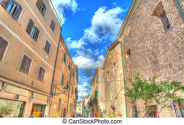 narrow street in Alghero old town on a clear day