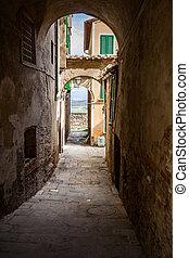 Narrow Street in an Old Italian Town. Tuscany, Italy