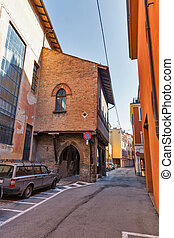 Narrow street in Bologna, Italy.